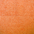 Orange sweater pattern detail background — Stock Photo
