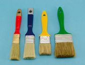 Paint brush color size on blue — Stock Photo