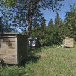 Stock Video: Beekeeping. hives in garden and its inhabitants bees.
