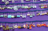 Handmade decorative earring jewelry sell fair — Stock Photo