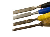 Four chisel graver carve tools on white — Stock Photo