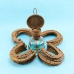 Retro kerosene lamp clover rusty horse shoes blue — Stock Photo #14939777