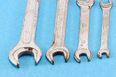 Set size wrench screw tools on blue — Stock Photo