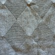 Stock Photo: Knitted wool pattern rhomb form grey background