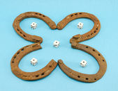 Clover retro horse shoes gamble dice on blue — Stock Photo