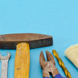Various construction work tools on blue - Stock Photo