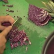 Red cabbage cut with knife. healthy ecological food. - Stock Photo
