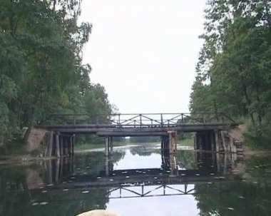 Amazing view filmed floating with motor boat under river bridge. — Stock Video