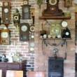 Vintage different clock collection set museum exhibition room — Stock Video #16871599