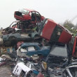 Stock Video: Junkyard full of used car bodies and other metal scrap.
