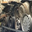 Stock Video: Wheels tires and body parts. automobile parts in dump.