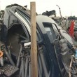 Stock Video: Dismantled old car parts. trade in second-hand car parts.