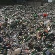 Glass recycling. square is full of old glass and plastic bottles — Stock Video