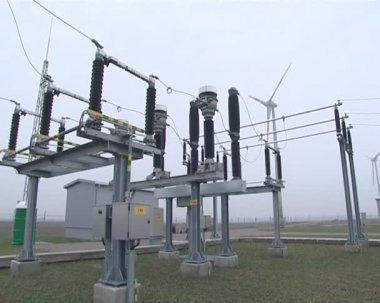 Windmill near power transformer. green power supplies to network — Stock Video