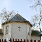 Small retro wooden rural church autumn trees sky — Stock Photo #18564067