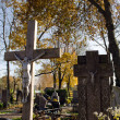 Crucifix cross jesus cemetery headstone autumn — Stock Photo