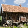 Different retro rural tools old wooden log house - Stock Photo