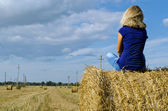 Blond woman girl teen sit straw bale — Stock Photo