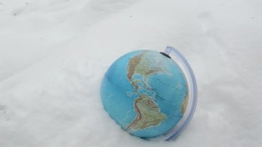 Earth globe snow hat hand — Stock Video