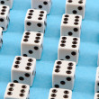 White gamble dice black dots blue background — Stok Fotoğraf #19759523