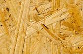 Wooden pressed shaving background — Stock Photo