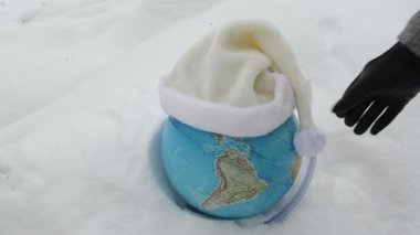 Earth globe sphere snow snowbank hand take white hat concept — Stock Video