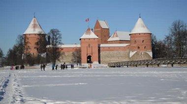 Trakai castle fortification frozen Galves lake winter — Stock Video