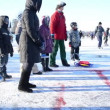 Stock Video: Play curling eisstock skate frozen lake ice Trakai winter