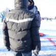 Stock Video: Active play winter game eisstock curling Trakai castle