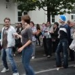 Stock Video: Musicians play dance accordion violin entertain street