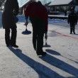 Stock Video: Play winter game curling eisstock frozen lake ice Trakai