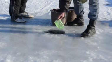 Man draw water ice hole pour bucket winter skate site prepare — Stock Video