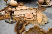 Decorative trays bowls cups of wood on bear fur — Stockfoto
