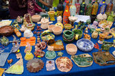Clay crockery kid craft wares outdoor fair — Stock Photo