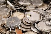 Retro old watches clocks parts pile heap closeup — Stock Photo