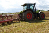 Tractor closeup plow furrow agriculture field — Stock Photo