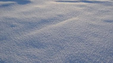 Fluffy friable snow footprints frozen lake and beautiful sun sky — Stock Video