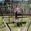 Stock Video: Old corroded field harrow tool stand wooden fence