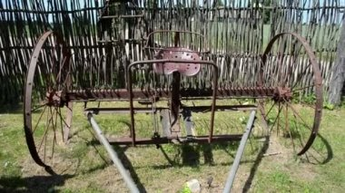 Old corroded field harrow tool stand wooden fence — ストックビデオ