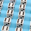 White gamble dice black dots blue background — Stok Fotoğraf #21746563
