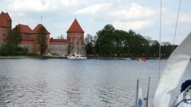Yacht move in wind. recreate trakai castle — Stock Video