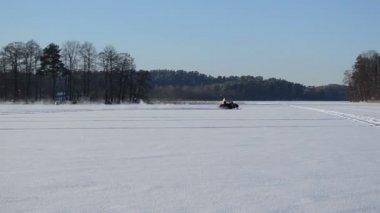 Man ride snowmobile transport lake ice winter extreme sport — Stock Video