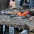 Stock Video: Iron steel rod heat glow fire ember prepare blacksmith hammering