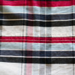 Fabric cotton square red blue black background - Stock Photo