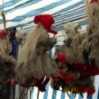 Stock Video: Fair exposition of witches on brooms of straw tow and materials