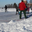 Kid children throw pin figures play winter game eisstock curling — Stock Video