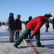 Stock Video: Play eisstock curling skate frozen lake ice Trakai winter