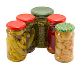 Mushrooms peppers cucumbers tomatoes preserve jar — Stock Photo
