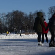 Active people winter sports skate on lake ice clean snow - Stock Photo