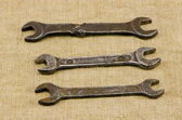 Three retro screw spanners wrench tools on linen — Stock Photo